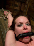 restrained-fully-nude-brunette-gets-her-shaved-pussy-pounded-hard-in-front-of-spectators