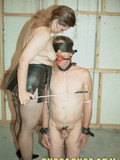 blindfolded-naked-guy-with-ball-gag-in-his-mouth-gets-his-cock-tortured-by-mistress