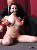 enthusiastic-bald-master-plays-with-helpless-brunette-s-tits-and-pussy