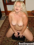 big-racked-blonde-woman-removes-her-white-lingerie-and-rides-sybian-in-the-middle-of-the-room