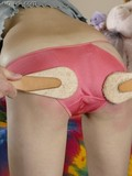 brunette-girl-in-panties-bends-over-and-gets-double-spanked-by-a-man-and-a-woman