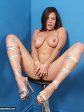 big-racked-brunette-rebekah-dee-strips-out-of-her-white-suit-on-a-stool-in-the-corner