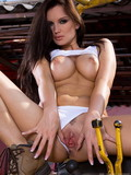 horny-brunette-babe-sandra-shine-has-a-yellow-helmet-on-when-stripping-in-the-shop