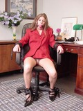 leggy-secretary-in-smart-red-suit-is-tied-to-office-chair-and-ballgagged