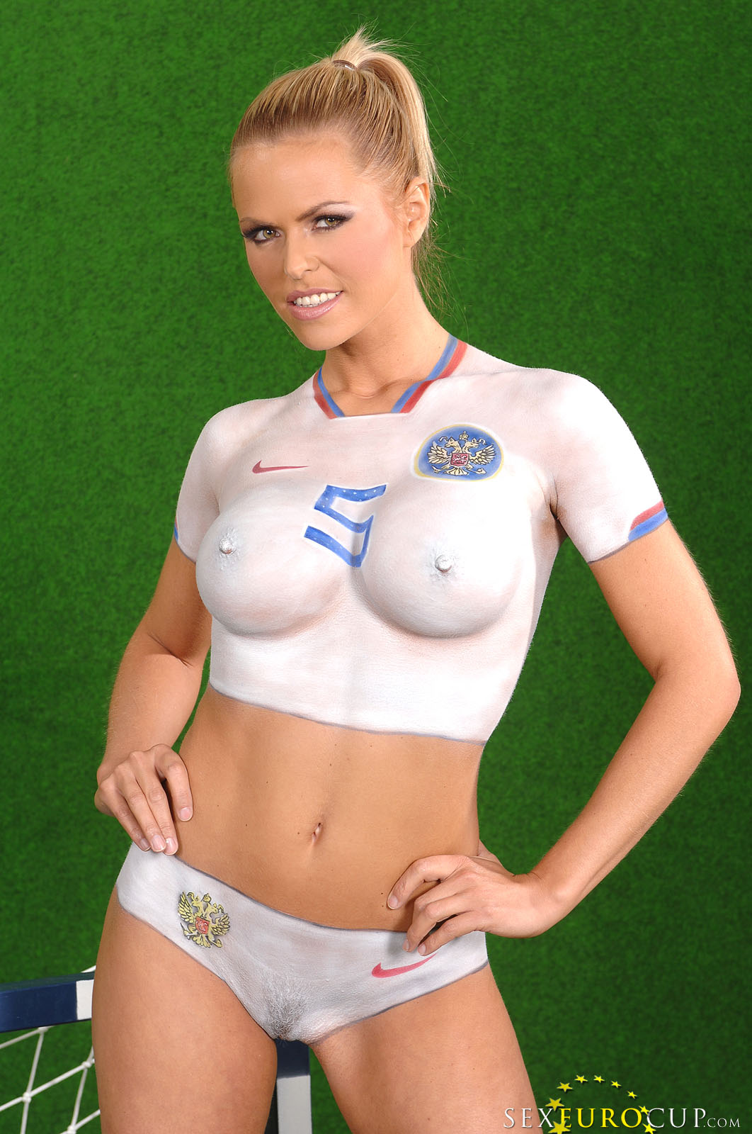 pretty faced smiling babes with perfect bodies pose in painted soccer
