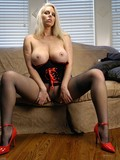 hot-blonde-in-red-high-heel-shoes-and-black-pantyhose-masturbates-her-pussy