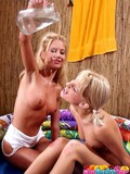 tight-lesbian-chicks-take-off-their-wet-shorts-and-panties-while-playing-with-water