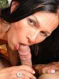 round-titted-brunette-shemale-takes-off-her-dress-and-licks-uncut-cock-of-her-lover