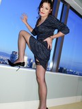 japanese-tranny-in-stockings-and-high-heels-takes-off-her-dress-and-lingerie-in-the-skyscraper