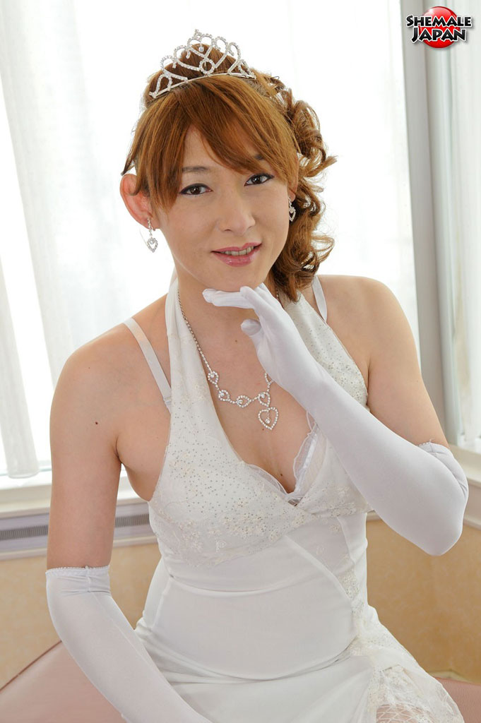 japanese shemale bride - Oriental transsexual bride dressed in white demonstrates her tiny nipples  and cock