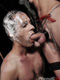nude-skinny-slave-man-with-wrapped-head-gets-mouth-fucked-by-transsexual-domina