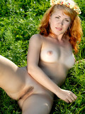 nude-pale-skinned-redhead-girl-shows-her-slit-in-the-green-green-grass