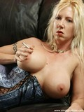 big-breasted-blonde-bitch-in-tight-corset-finds-herself-very-sexy-when-she-smokes