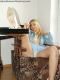 smoking-blonde-dressed-in-blue-shows-her-tits-and-flashes-her-white-panties