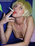 skinny-blonde-girl-with-sparkling-blue-eyes-flashes-her-tits-while-smoking