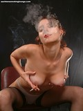beautiful-smoker-removes-her-red-blouse-and-bra-then-touches-her-sexy-tits
