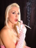 long-haired-blonde-smoker-in-pink-dress-and-long-gloves-does-it-flirtatiously