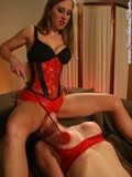 Lesbian mistress in red latex panties smothers her slave with her bottom