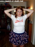 redhead-amateur-girl-in-blue-skirt-and-with-no-panties-bends-over-to-show-her-red-spanked-ass