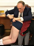schoolgirl-in-short-skirt-and-tight-panties-gets-her-buttocks-spanked-by-mature-principal
