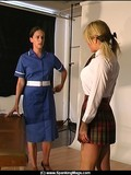 brunette-in-blue-uniform-checks-out-blonde-s-private-parts-before-she-spanks-her-ass