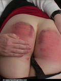 redhead-in-red-mini-skirt-and-black-pantyhose-gets-spanked-by-her-strict-father