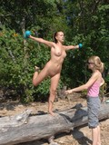 fully-nude-sexy-girl-does-exercises-outdoors-in-front-of-her-clothed-friend