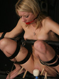 slim-bound-blonde-gets-her-nipples-tortured-and-her-bald-pussy-vibrated-in-the-dark