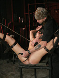 skinny-flat-chested-slave-brunette-gets-bound-and-whipped-in-the-dungeon