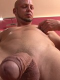Bald man gives a close-up of his veiny cock and takes off his sexy jocks