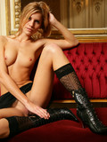 tall-beauty-with-tiny-hard-nipples-and-longest-legs-poses-naked-in-boots