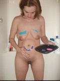 naked-frisky-amateur-girl-paints-her-saggy-tits-and-buttocks-in-the-shower