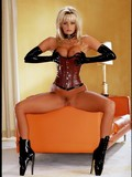 glamorous-blonde-elizabeth-hilden-in-tight-corset-and-high-heeled-boots-spreads-and-masturbates