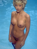 blonde-babe-with-perfectly-shaped-firm-tits-and-hairless-mound-poses-naked-in-the-pool