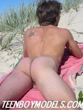 young-sexy-bodied-guy-with-adorable-body-poses-completely-nude-on-the-wild-beach