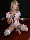 young-pole-dancer-in-sexy-nurse-uniform-strips-nude-and-exposes-her-private-parts