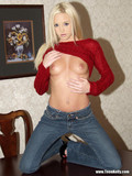 tight-teen-blonde-lifts-her-red-blouse-up-and-displays-her-small-tits-on-a-desk