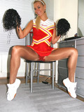 teenage-blonde-in-red-cheerleader-uniform-takes-off-her-tight-pantyhose