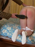blonde-girl-pulls-off-her-white-panties-and-gets-her-nude-bottom-spanked-by-her-angry-father