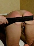 busty-brunette-flashes-her-shaved-pussy-as-she-gets-spanked-on-her-bare-ass