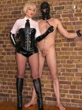 obedient-masked-man-gets-ruthlessly-tortured-by-latex-loving-uniformed-blonde-mistress