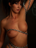 naked-long-legged-brunette-with-fine-tits-plays-with-chains-in-the-semi-dark