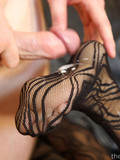 raven-haired-lady-in-black-crotchless-pantyhose-rides-stiff-cock-in-her-shaved-pussy