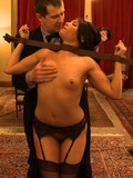 slave-brunettes-fondle-each-other-and-get-fucked-by-elegant-gentlemen-at-bdsm-party