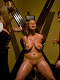 well-dressed-men-and-women-humiliate-obedient-busty-slave-girls-at-the-bondage-party