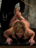 enslaved-naked-blonde-with-nice-tits-and-hairless-pussy-gets-her-nice-body-punished