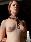 restrained-small-titted-redhead-slave-girl-gets-her-neat-pussy-attacked