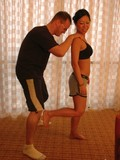 strong-asian-lady-tia-ling-shows-her-sexy-muscles-and-kicks-guys-balls
