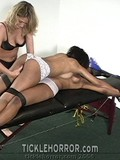 two-brunettes-are-tied-together-and-get-their-armpits-and-feet-tickled-by-dominating-blonde