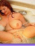 massive-titted-thick-redhead-plays-with-her-shaved-snatch-in-the-bathtub